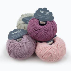 Quatre pelotes de Bébé Soft Wash de Kremke coloris Rose Layette, Parme, Erika et Gris Clair