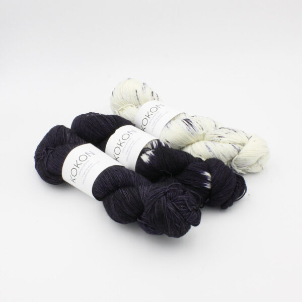 Three skeins of Kokon Bleu Fingering Weight, semi-solid, tie-dye and speckled