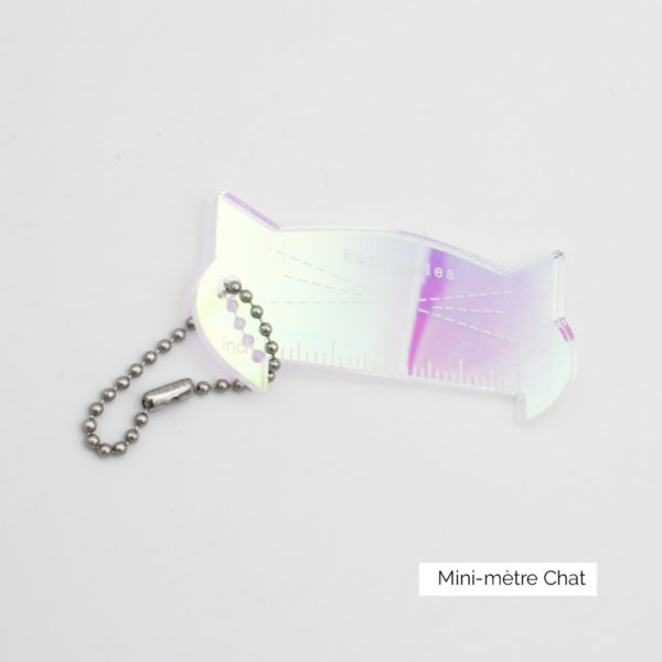 Display of a mini-ruler, made of iridescent acrylic and shaped as a cat head, designed by Katrinkles for their Cat Collection